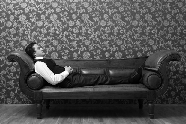 Photo of man reclined on sofa
