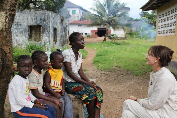 Photo of Nancy Snyderman with children and a young woman in Liberia