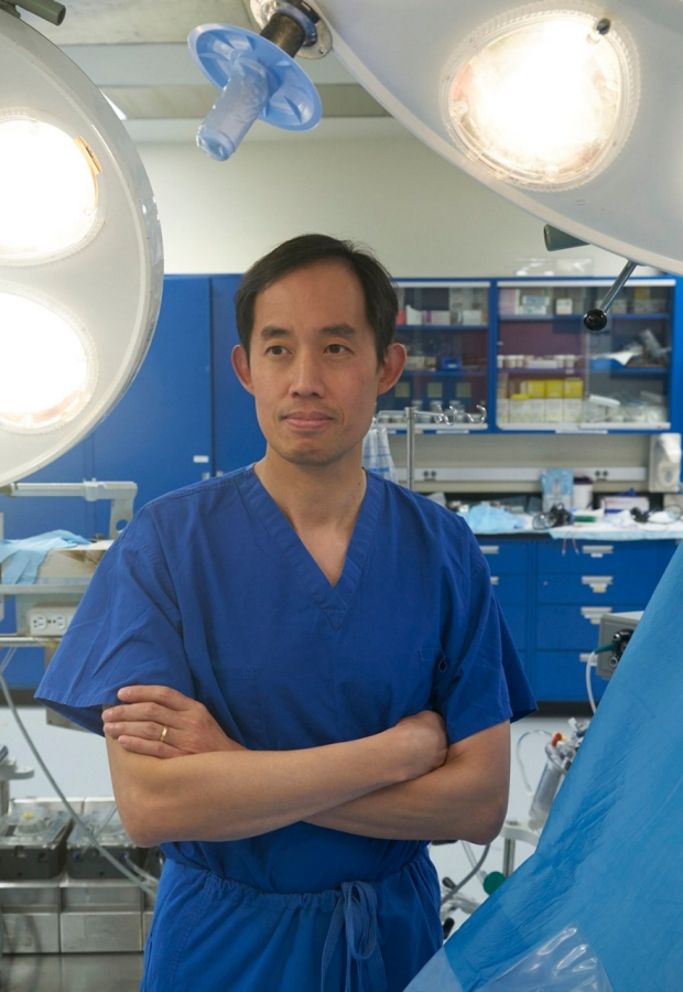 Joseph Woo, MD standing in operating room