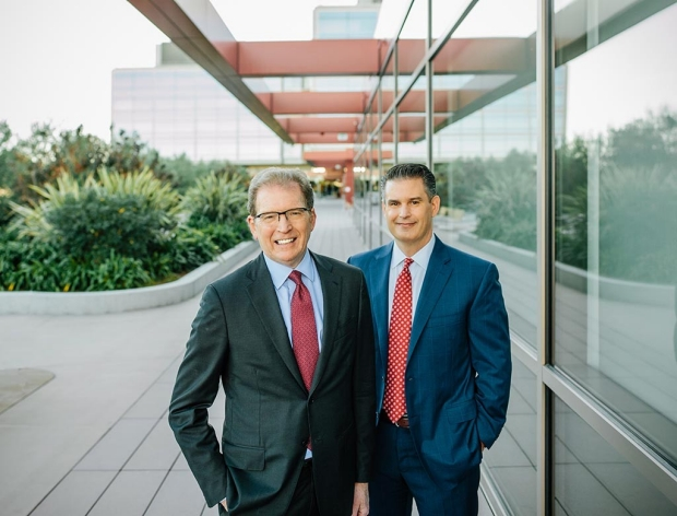 Dean Lloyd Minor, left, and Stanford Hospital CEO and Vice President David Entwistle.