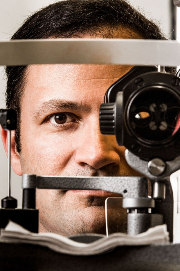 Man looking through an opthalmascope