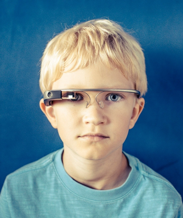 Alex, 9, wearing a Google Glass headset